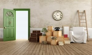 Vintage interior with cardboard boxes, scale, suitcase, armchair and books, ready for the move - rendering
